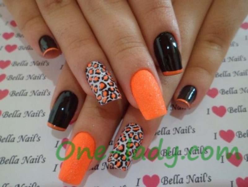 Оранжевый маникюр с черным фото